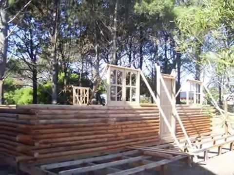 Construccion de cabañas de troncos en el partido de la costa
