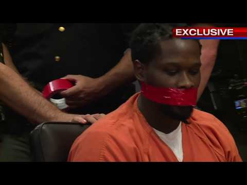 Man`s mouth duct taped hearing