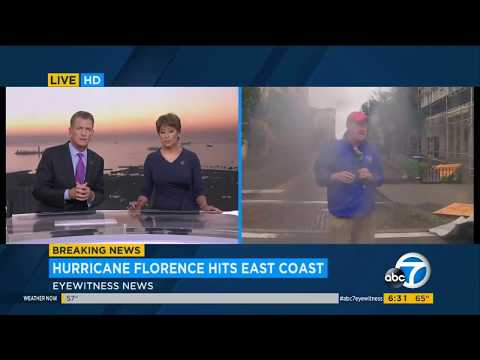 Reporter gets hit with storm debris during live shot | Hurricane Florence