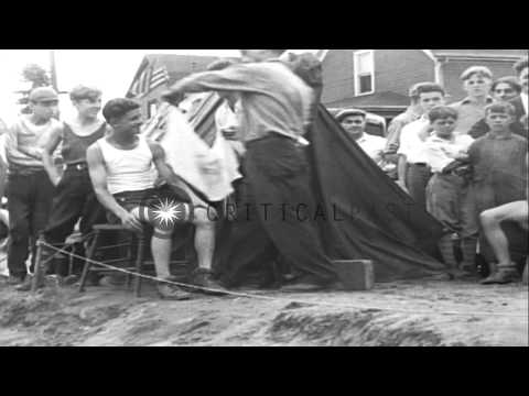 Jackson High School boys sleep and drink milk as they ride bicycles nonstop in Ha...HD Stock Footage