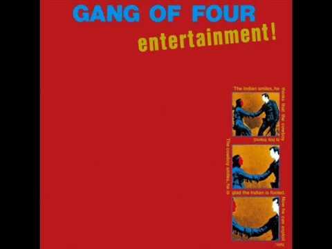 Tekst piosenki Gang of Four - At Home He's a Tourist po polsku