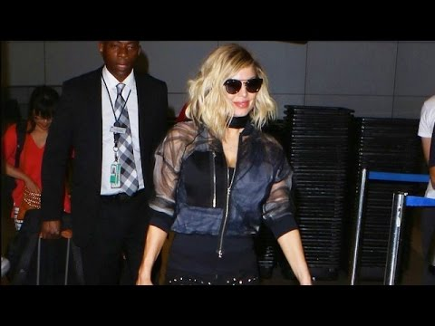 Fergie Draws Enormous Crowd At LAX In Sexy Bomber Jacket