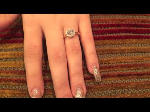 Round Cubic Zirconia Halo Style Ring in 14K Yellow Gold / 8476