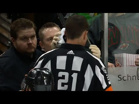 Flames' Ferland rings puck off crossbar, hits unlucky ref in the ear