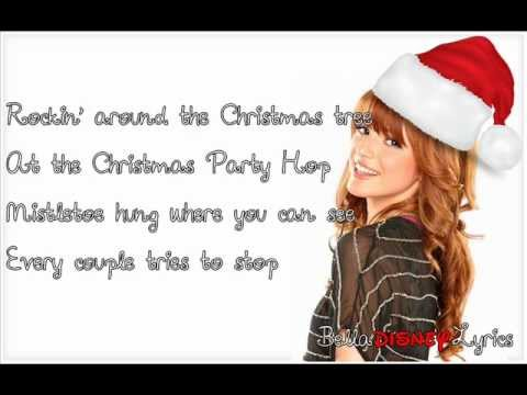 Tekst piosenki Bella Thorne - Rockin' Around The Christmas Tree po polsku