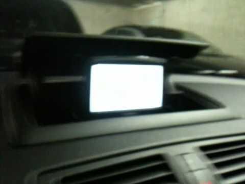 BMW e87 TomTom im Ablagefach mit Klappmechanik