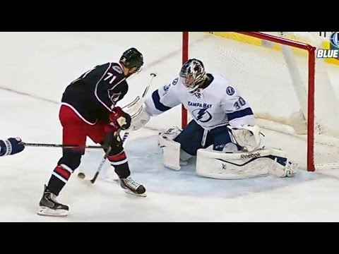 an - Columbus Blue Jackets forward Nick Foligno goes between the legs to send it by Tampa Bay Lightning goaltender Ben Bishop to take a 1-0 lead in the 2nd period.