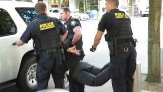 homeland security pulls guns and arrest protester and pain compliance