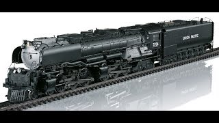 """REYNAULDS.COM presents a video on the HO Scale Marklin & Trix Union Pacific Challenger locomotives.  These massive Articulated 4-6-6-4 locomotives were built by American Locomotive Company for the Union Pacific Railroad. 105 of these incredible locomotives were built between 1936 and 1943.  The Challengers were nearly 122 ft long and weighed an incredible 314 tons. They operated over most of the Union Pacific system, primarily in freight service, but a few were assigned to passenger trains operating through mountain territories in California and Oregon. The locomotives were built specifically for Union Pacific and much of the experience and knowledge gained went into the design of the iconic """"Big Boy""""The name """"Challenger"""" was given to steam locomotives with a 4-6-6-4 wheel arrangement. This means that they have four wheels in the leading pilot truck, which helps guide the locomotive into curves, two sets of six driving wheels, and finally four trailing wheels, which support the rear of the engine and its massive firebox. Each set of six driving wheels is driven by two steam cylinders. In essence, the result is two engines under one boiler. The Union Pacific Railroad sponsored development of these designs because they wanted higher speeds in main-line service. Historically, articulated locomotives had been limited to slow speeds by factors inherent in their design. The technical breakthroughs achieved with the Challenger enabled the Union Pacific to develop the Big Boy with the same speed expectations. Speeds in excess of 60 M.P.H., while unheard-of on other railroads using articulated steam locomotives, became common place on the Union Pacific.Model: Both the AC and DC Challengers are equipped with digital sound decoders with extensive sound functions even the sound of the opening and closing of the cab windows. Model is mostly made of metal and all 6 axles are powered by a strong 5 pole can motor with flywheels. Model also features LED headlights on locomotive and """