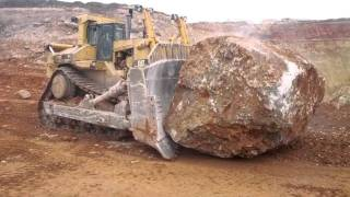 Caterpillar Pushing Another Massive Rock