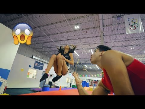 TEACHING MY WIFE HOW TO BACKFLIP (super funny)