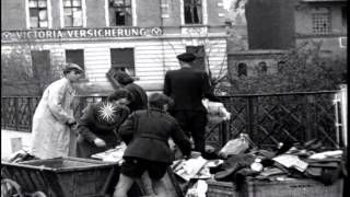 Nordhausen Germany  city photos gallery : Civilians with looted goods in Nordhausen, Germany. HD Stock Footage