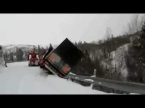 Tow Truck and Trailer Roll Off Mountain Cliff