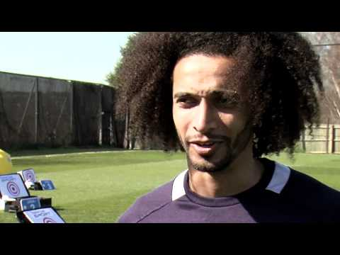 Ekotto - Benoit Assou-Ekotto takes on a Tottenham fan Geoff Gelbier in the Thomas Cook Suitcase Challenge at The Lodge.