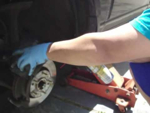change brakes - An exclusive educational video on how to change brake pads all by yourself on a 2006 Kia Sportage.