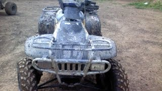 6. How to adjust the chain on a Polaris Trail Boss 330