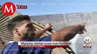 Migrantes intentan cruzar muro fronterizo; agentes de EU lanzan gas lacrimógeno