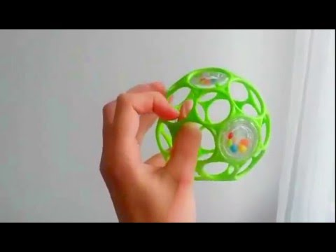Playing with toy - Oball rattle