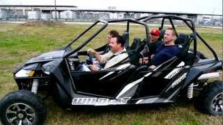 1. 4 Grown Men in a 2013 Arctic Cat Wildcat 4