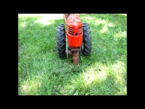 david bradley tractor - 5756 DB with sickle mower attachment mowing around our garden area. Please subscribe as I will be posting more DB stuff in the future.