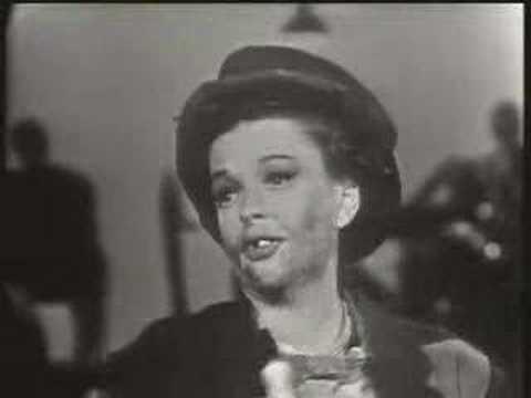 Tekst piosenki Judy Garland - We're A Couple Of Swells po polsku