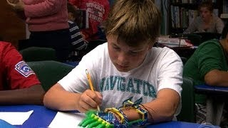 Boys prosthetic hand made by 3-D printer