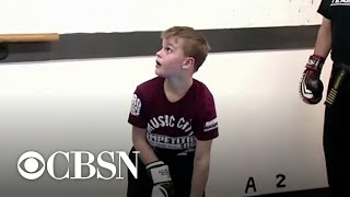Military dad brings son to tears with surprise homecoming during martial arts practice