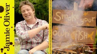 No need to go to the expense of a smoker when all you need is an old bucket!  Jamie shows you how to smoke some beautiful trout fillets and prawns quickly and easily using some skewers and a damp tea towel.  A fantastic way to cook outdoors and guarantee amazing results!This recipe first aired on Ch4 in 2012 as part of Jamie's Summer Food Rave UpLinks from the video:Prawn Linguini  http://jamieol.com/FTPrawnLinguineBBQ Tips  http://jamieol.com/BBQtipsCharred Veg Salad  http://jamieol.com/CharredVegSaladTasty Fish Tacos  http://jamieol.com/TastyFishTacosFor more information on any Jamie Oliver products featured on the channel click here: http://www.jamieoliver.com/shop/homeware/For more nutrition info, click here: http://jamieol.com/NutritionSubscribe to Food Tube  http://jamieol.com/FoodTubeSubscribe to Drinks Tube  http://jamieol.com/DrinksTubeSubscribe to Family Food Tube  http://jamieol.com/FamilyFoodTubeTwitter  http://jamieol.com/FTTwitterInstagram http://jamieol.com/FTInstagramFacebook  http://jamieol.com/FTFacebookMore great recipes  http://www.jamieoliver.comJamie's Recipes App  http://jamieol.com/JamieApp#FOODTUBEx