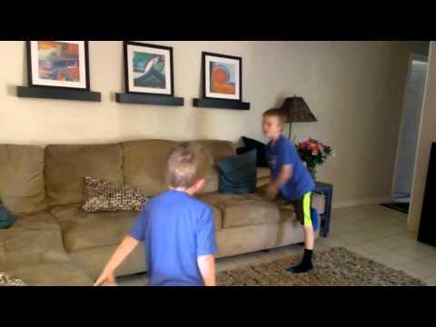 Jake and Nathan play football at Granny's house.