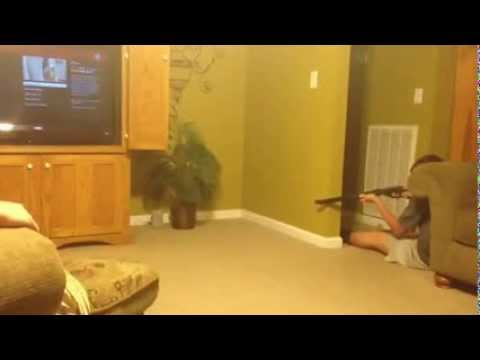 Boy tries to shoot a mouse with a BB gun.