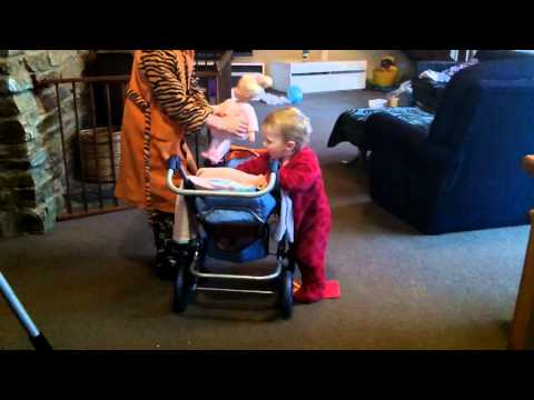 Dasiy with new pram and dolly.MP4
