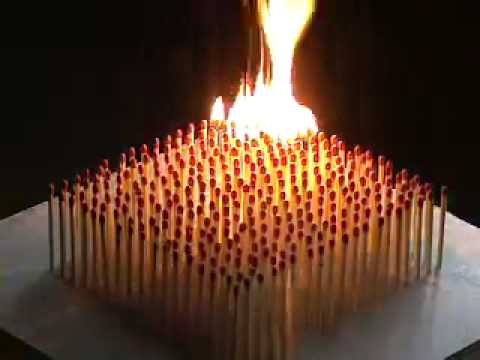 chain reaction - Grid of over 300 standing wooden matches is lit from one corner.