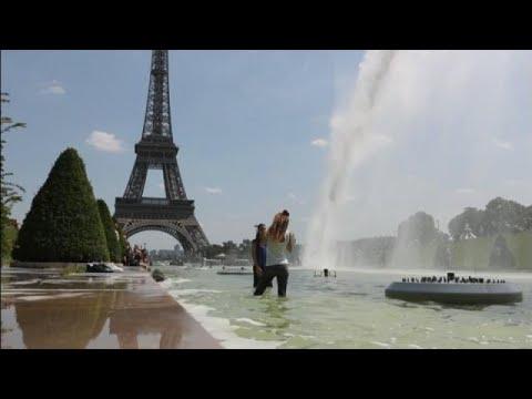 Imagens de calor - Onda de calor faz franceses mergulharem em fontes em Paris