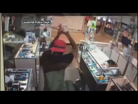 Caught On Camera: Man Uses Metal Pole & A Samurai Sword To Attack Two People!