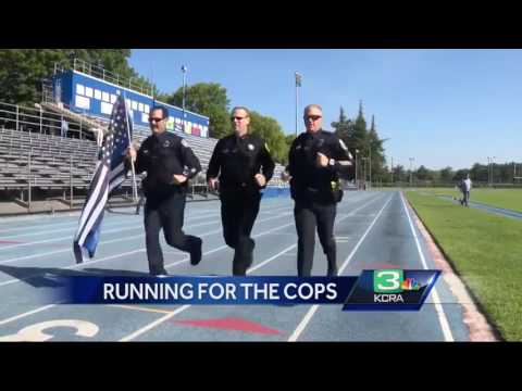 These officers are going to run a marathon in their police uniforms