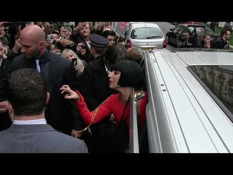 EXCLUSIVE – All red Lady Gaga leaves the Bristol Hotel in Paris