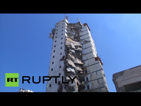 Israel - 25 people were injured on Tuesday when Israel bombed two Gaza City high-rises containing dozens of homes and shops, according to health officials. One building collapsed and the other was severely...