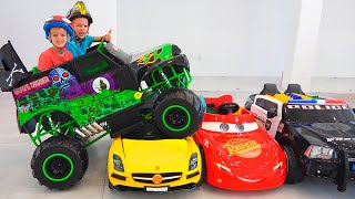 Vlad and Nikita ride on toy monster truck and goes through the cars for kids