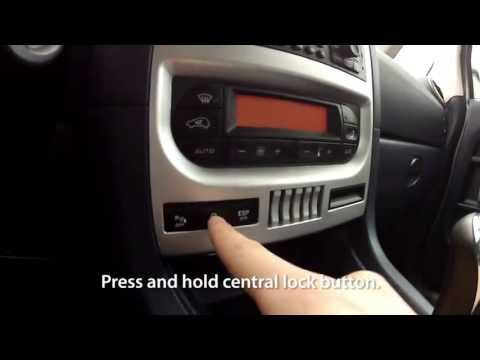 How to enable auto-locking central lock in Peugeot 1007 (anti hijack)