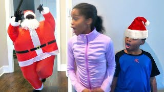 Bad Baby Santa Claus ATTACKS! Christmas Present EXPLOSION - Onyx Kids Shiloh and Shasha are eating candy canes and...