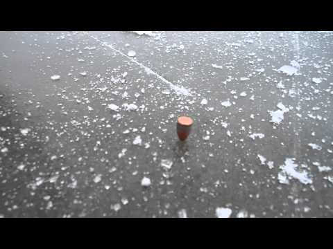 Bullet spins on ice after being shot