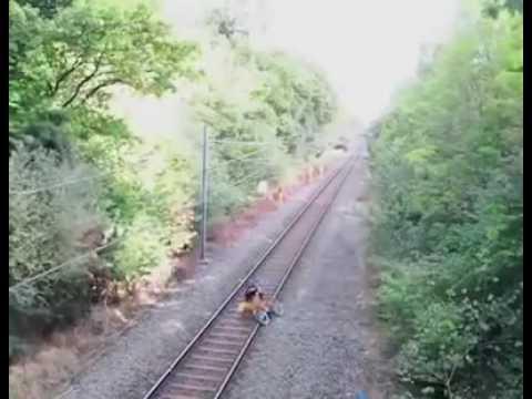 Video Drunked man cross the railway track that time train comes and railway staff amazing jump and protect download in MP3, 3GP, MP4, WEBM, AVI, FLV January 2017
