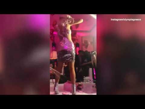 Paris Hilton dances on a table and steps cake at birthday bash