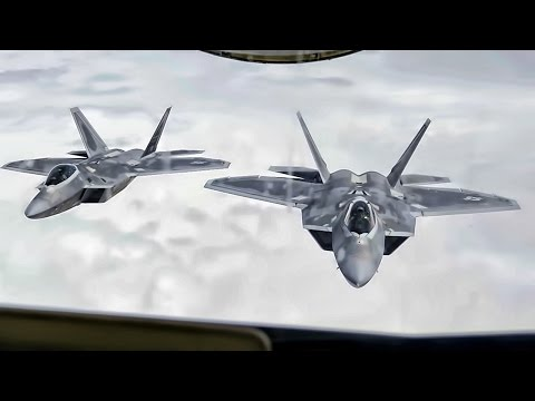 Two U.S. Air Force F-22 Raptors...
