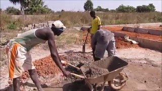 Building a house in Gambia is a lot of work in the heat. The blocks are handmade, and dried in the sun, the concrete is handmade and put in by hand in a whee...