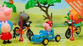 Джордж и Пеппа на автомобильных гонках