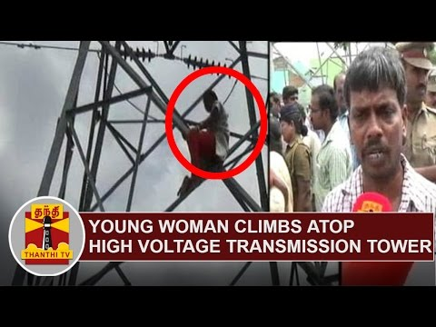 Young-Woman-climbs-atop-high-voltage-transmission-tower-demanding-New-Electricity-Connection