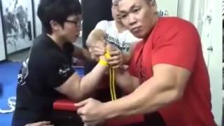 Never Underestimate The Little Guy In Arm Wrestling