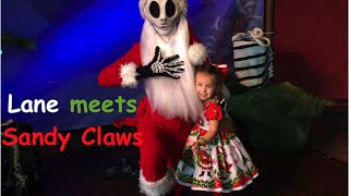 Jack Skellington dressed as Sandy Claws visited Mickey's Very Merry Christmas Party and Lane couldn't wait to pay him a visit.