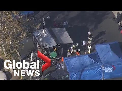 Aerial video shows investigative team searching car, residence of suspected California bar shooter
